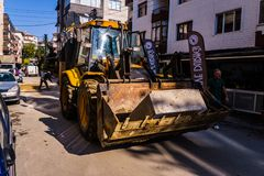 Backhoe Loader In Middle Of A Street Royalty Free Stock Photo