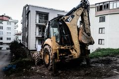 Backhoe Loader In Side Street Stock Photography
