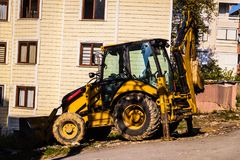 Backhoe Loader In Side Street Stock Image