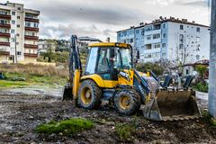 Backhoe Loader In Side Street Stock Images