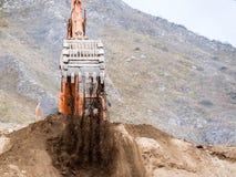 Backhoe loader working in earthmoving Stock Photo