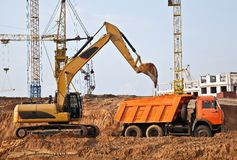 Backhoe loading a dump truck Royalty Free Stock Images