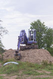 Backhoe on mound. Industry Royalty Free Stock Photography