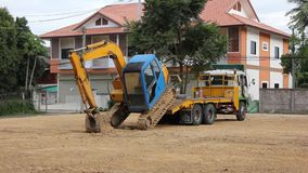Backhoe move up to truck. Footage at chiangmai , thailand stock video