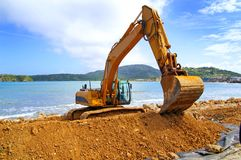 Backhoe moving soil Royalty Free Stock Photo