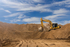 Backhoe On The Sand Against The Sky. Stock Image