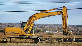 Backhoe on an open field to be developed Stock Image
