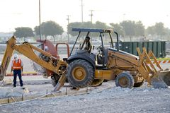 Backhoe operator. The backhoe operator digs a large hole Royalty Free Stock Photography