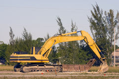 Backhoe at rest during lunch. Backhoe at rest during a lunch break for the operator Stock Photo
