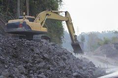 Backhoe:Road construction in mountains Khao kho phetchaboon Royalty Free Stock Photo