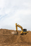 Backhoe on the sand track. Royalty Free Stock Image