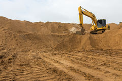 Backhoe on the sand track. Stock Images