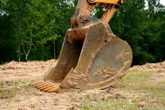 Backhoe scoop. The scooping shovel on a back hoe royalty free stock image