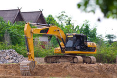 Backhoe Service. Were digging along the river Stock Images