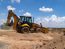 Backhoe Shoveling Dirt Royalty Free Stock Photos