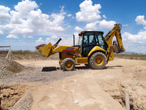 Backhoe Shoveling Gravel Stock Photo