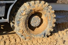 Backhoe tires. Dirty backhoe on construction site Stock Image