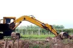 Backhoe was digging a pit in the ground. Crawler excavator truck.  stock photos