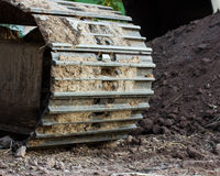 Backhoe wheel located on site Stock Photo