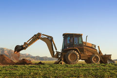 Backhoe at Work. A construction backhoe digging in Utah Stock Photography