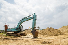 Backhoe is working in the construction site Stock Images