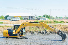 Backhoe working in mud swamp Stock Images