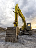 Backhoe. Yellow excavator loader machine at construction site over a cloudy sky Royalty Free Stock Images