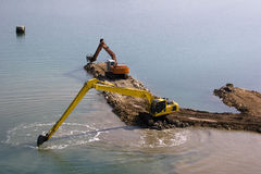Backhoes working in the sea Royalty Free Stock Photos