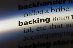 Backing. Word in a dictionary.  concept Royalty Free Stock Images