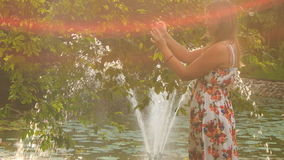 Backlight Backside Blond Girl Photos Fountain behind Tree stock footage