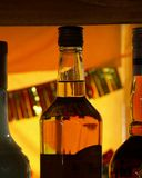 backlight butelki pomarańcze Obrazy Stock