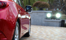 Backlight of new car in ray of spotlights on privat parking stock photo Royalty Free Stock Photo
