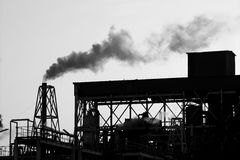 Backlight petrochemical industry smoke sky Stock Image