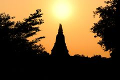 Backlight picture sunrise pagoda At wat chaiwatthanaram The old temple of Ayutthaya period.  royalty free stock photos