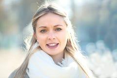 Backlight portrait of a beautiful woman. Backlit outdoor portrait of a beautiful blond woman on a city street Royalty Free Stock Photo