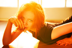 Backlight portrait of young beautiful redhead woma Stock Photography