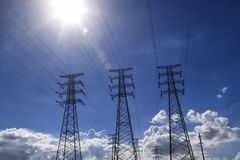 Backlight Power Transmission Tower  Group Stock Photos