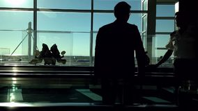 Backlight shot of people on travelator in YVR airport stock footage