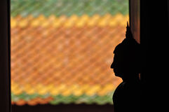 Backlight Silhouette of Buddha. Stock Images