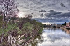 Backlight of a sunset over the river Ebro in the city of Logroño in Spain with the sky full of black clouds threatening rain, wit stock photo