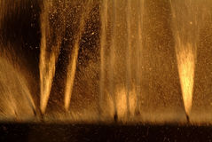 Backlight  of water splashing fountain in the evening with a lig Stock Image