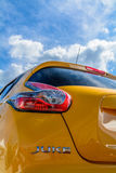 Backlight of yellow car closeup on a background of sky. Vertical Royalty Free Stock Image