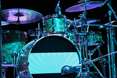 Backlighted drum set. With bass drum, tom-toms, cymbals and microphones Stock Image