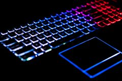 Backlighted gaming keyboard with great colors. With backlighted gaming keyboard the gamer can program the keys with desible and useful colors for gaming. In this Stock Photo