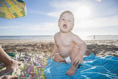 Backlighting baby at beach Royalty Free Stock Photos