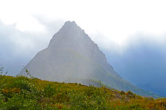 Backlighting on mountain in Glacier National Park. Royalty Free Stock Photos