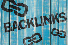 Backlinks sign. A black backlinks skgn on a blue wooden fence Stock Photography
