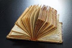 Backlit antique book Stock Images