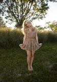 Backlit Blond in Sun Dress Stock Image