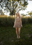 Backlit Blond in Sun Dress Stock Image